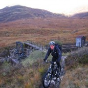 Crossing the dam at Loch Eilde Mor to start following the feed pipe all the way to Blackwater Reservoir.