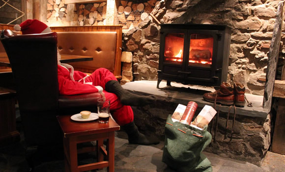 Father Christmas by the fire