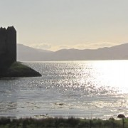 Castle Stalker viewed from the Sustrans Cycle Route on an early summer day.