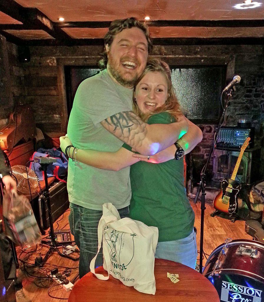 Raffle winners hug